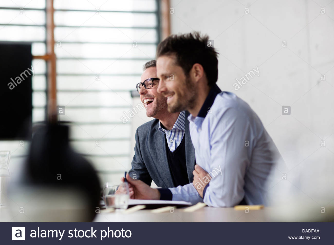 Two men laughing - Stock Image