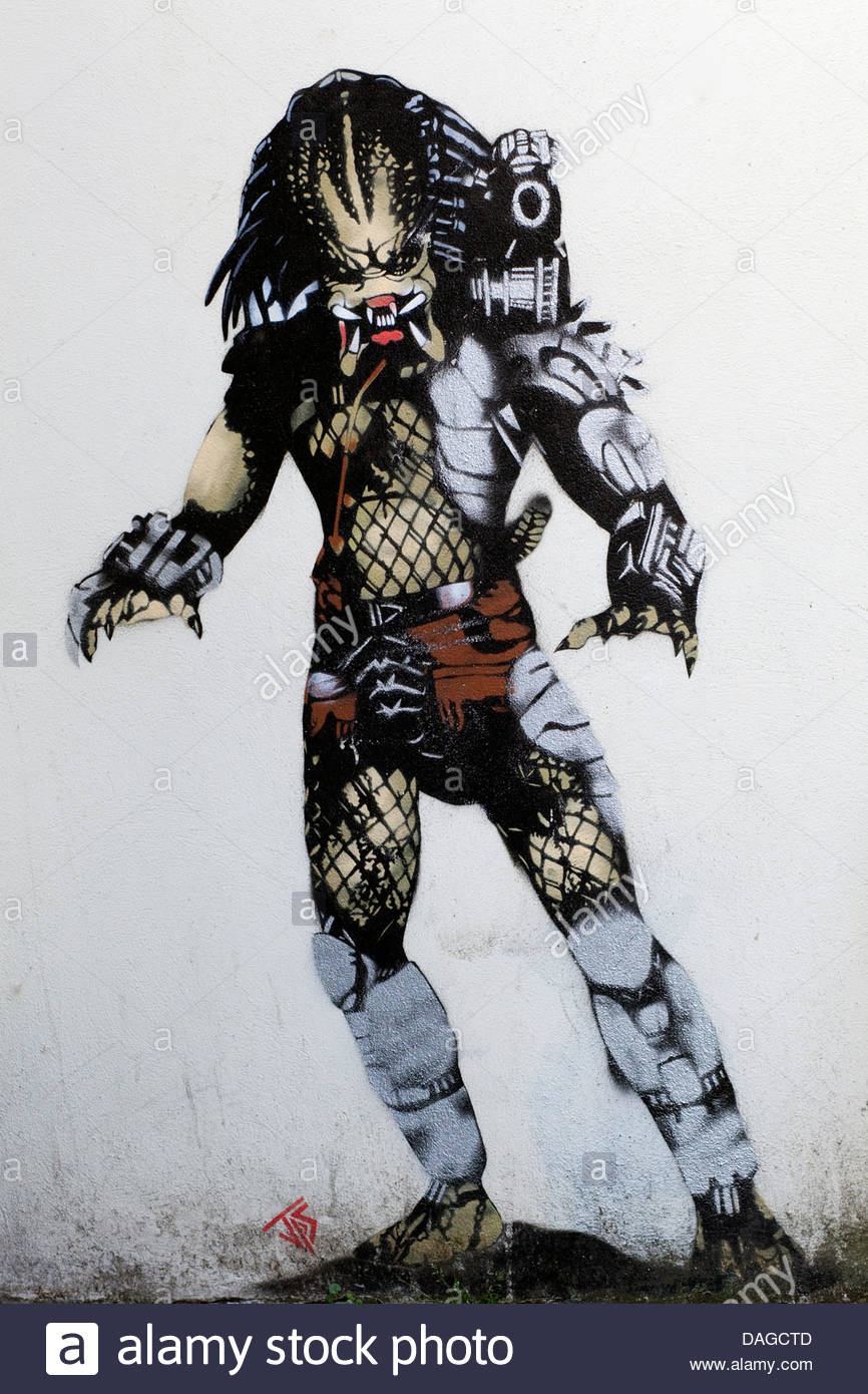 Graffiti wall Art Predator from the action film - Stock Image