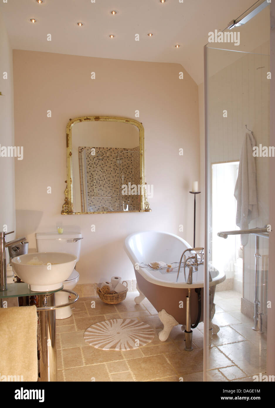 Roll top bath and large glass shower cabinet in modern bathroom with roll top bath and large glass shower cabinet in modern bathroom with large antique mirror and stone tiled floor dailygadgetfo Gallery