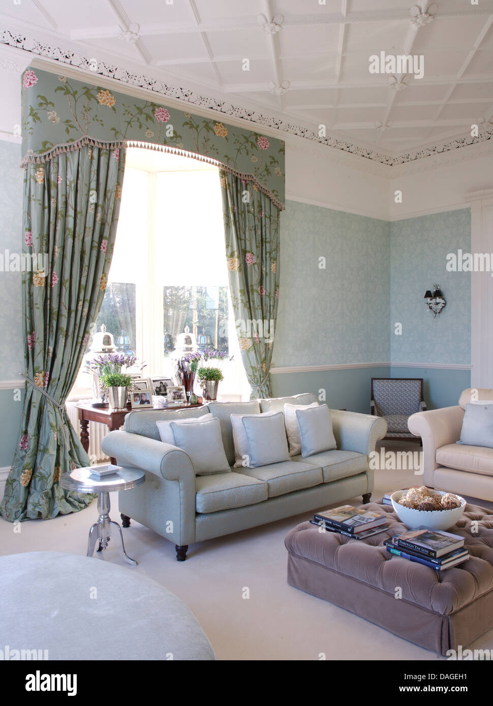 Blue Pink Floral Curtains In Pale Living Room With Sofa And Gray Velvet Ottoman