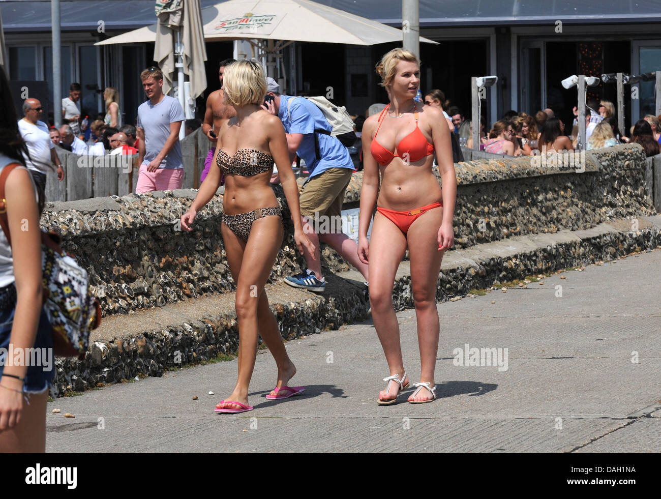 Brighton UK 13 July 2013 - Young women in bikinis on Brighton seafront today as the heatwave in Britain continued Stock Photo