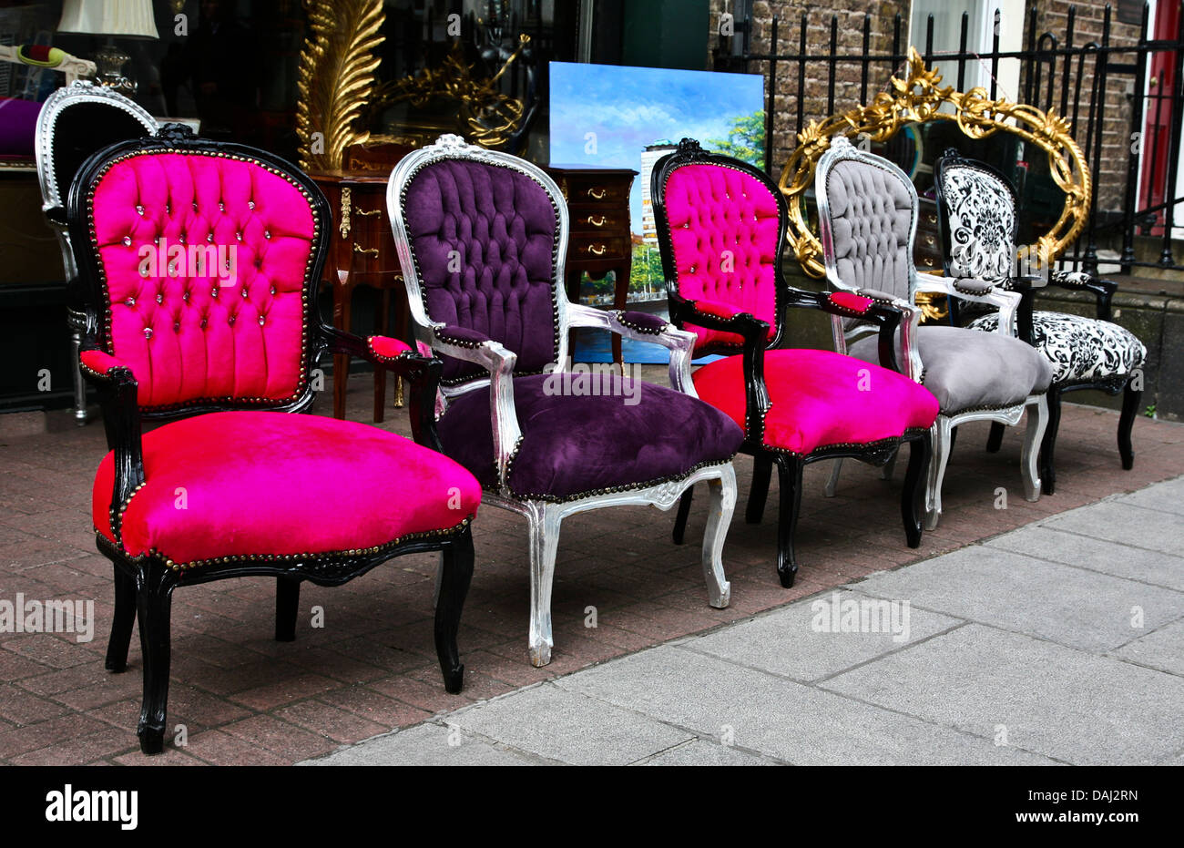 Colorful outdoor close up Victorian antique chairs displayed in a row in front of an antique store in Dublin Ireland vintage objects chair abstract & Colorful outdoor close up Victorian antique chairs displayed in a ...