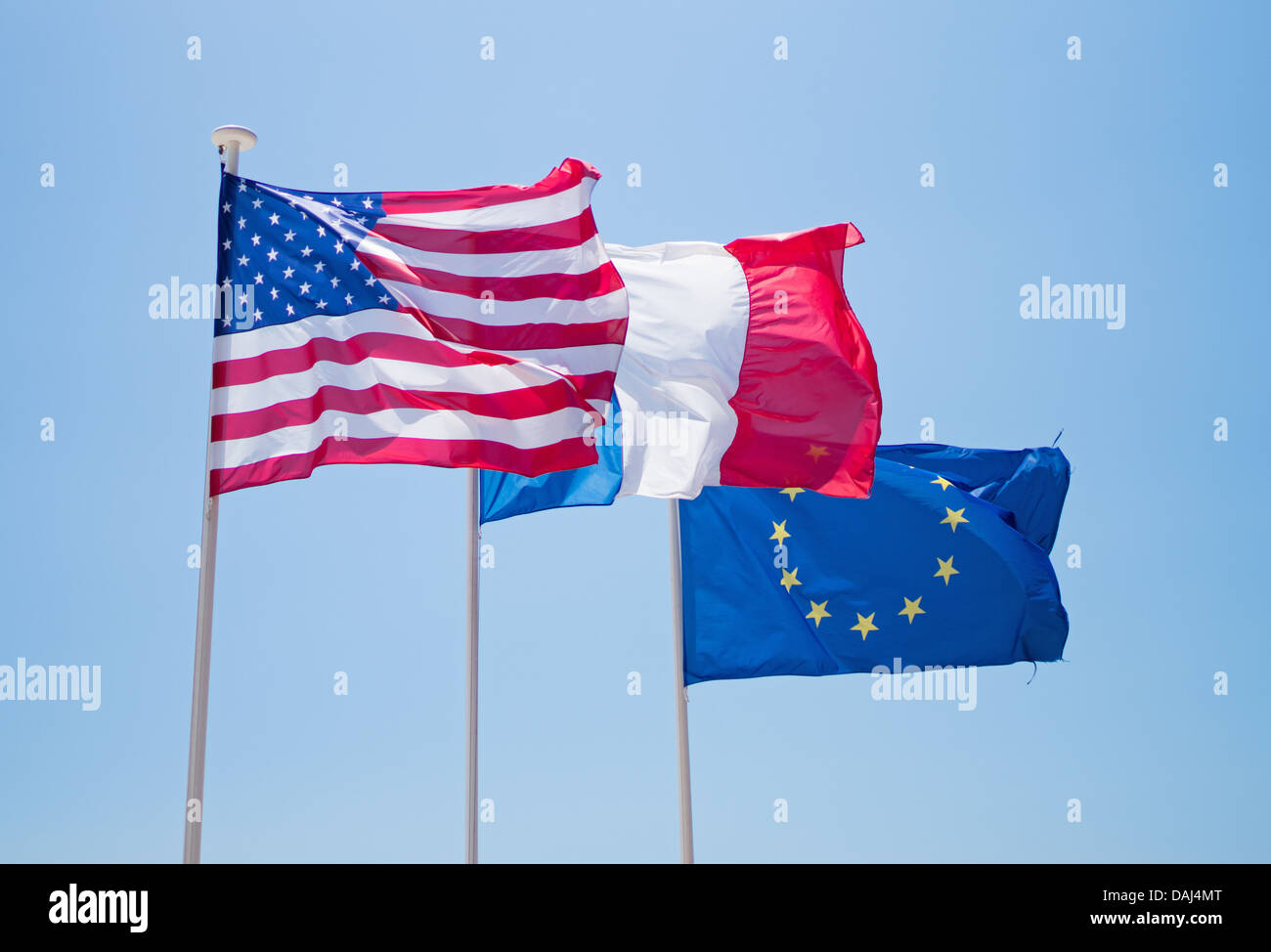 National flags of USA, and France with  the EEC flag, flying above the promenade in Nice, France - Stock Image