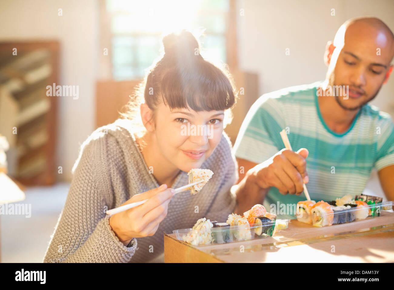 Couple eating sushi together Stock Photo