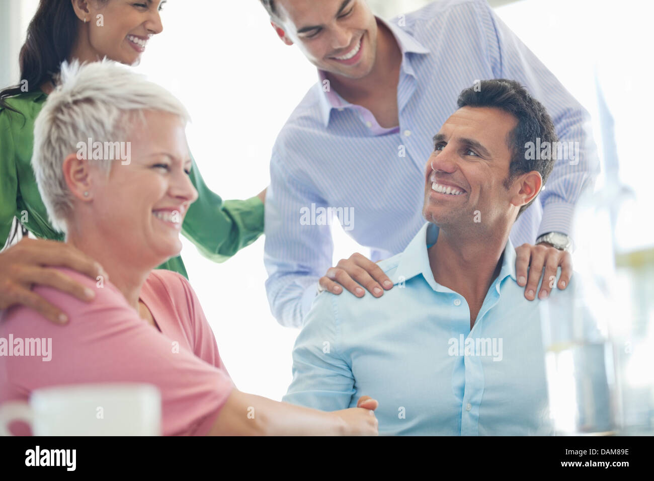 Business people laughing in meeting - Stock Image
