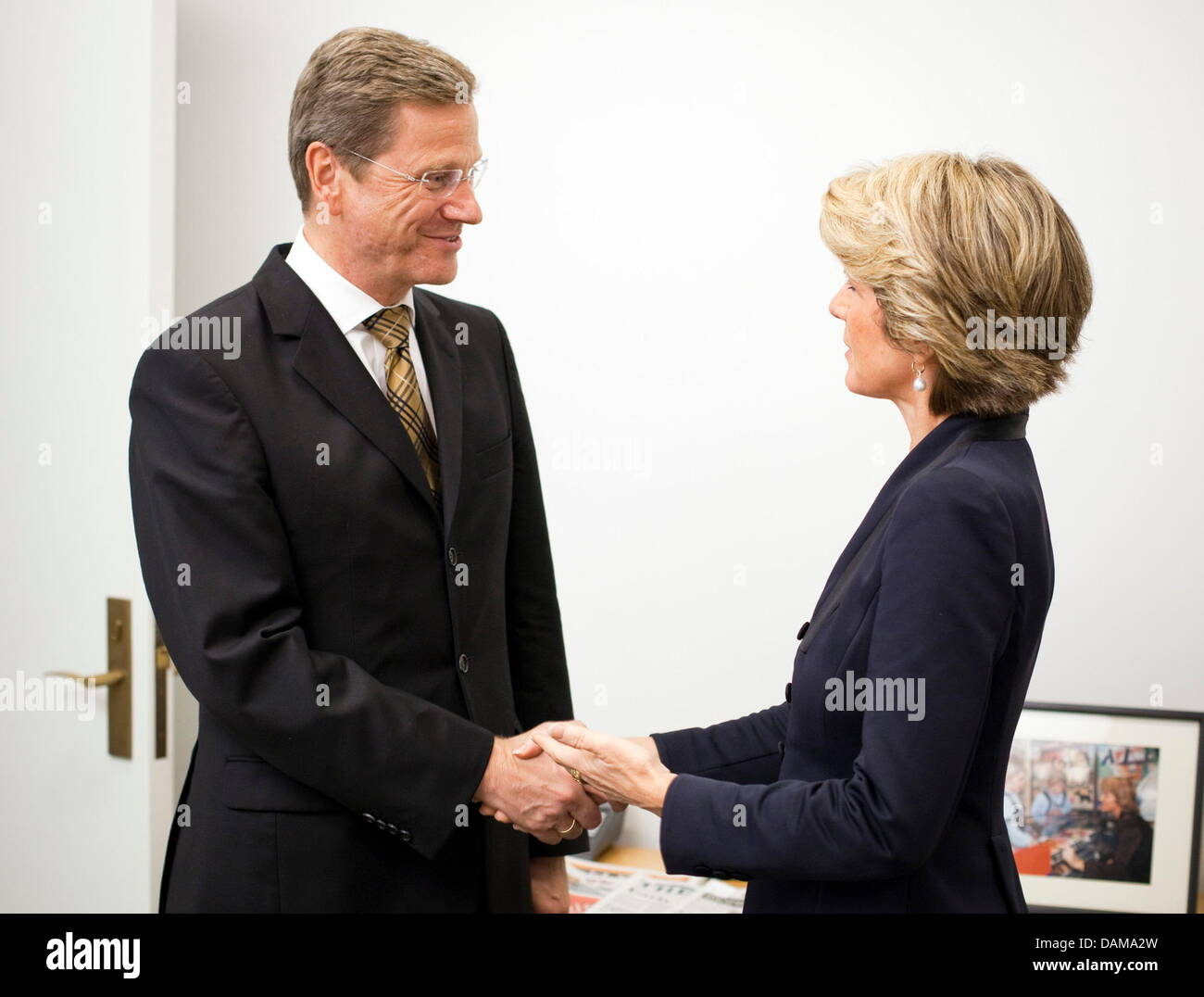 German Foreign Minister Guido Westerwelle L Shakes Hands With