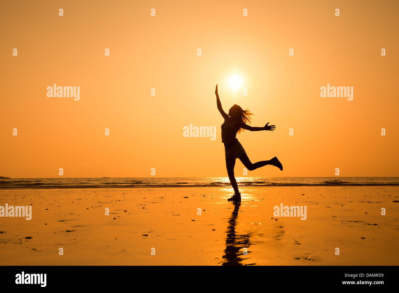 abstract silhouette of happy young jumping girl, healthy life - Stock Image