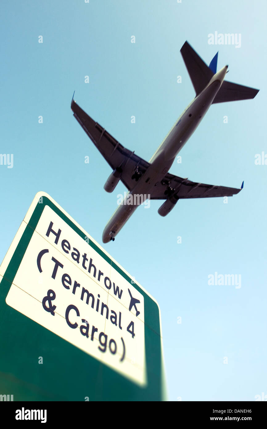 Commercial airliner and Heathrow sign - Stock Image