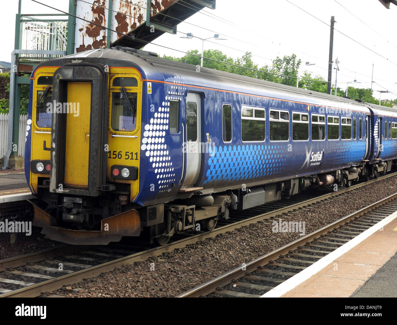 Scotrail,156511,Edinburgh,to,Glasgow,train,at,Slateford,Railway,Station,commuter,transport,evening,diesel,DMU,EH14,1BX,EH141BX,capital,city,sprinter,railroad,class156,class,156,BR,British,Rail,multiple-unit,multipleunit,multiple,unit,Metro-Cammell,Alstom,two-car,sets,two,car,FirstGroup,gotonysmith,Shotts,Line,-,Glasgow,Central,to,Edinburgh,Waverley,via,Cambuslang,Bellshill,and,Shotts,Saltire,markings,on,the,carriage,ends,Buy Pictures of,Buy Images Of