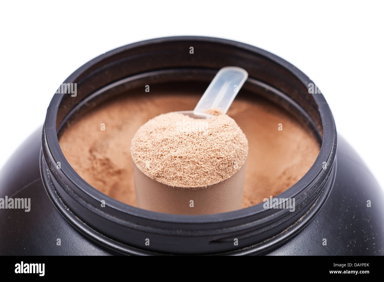 Scoop of chocolate whey isolate protein in a black plastic container on white - Stock Image