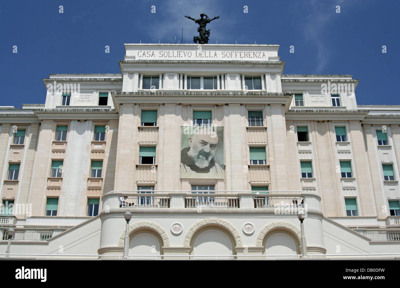 The  hospital displaying a huge banner of Padre Pio on its facade is pictured in San Giovanni Rotondo, Italy, 12 - Stock Image