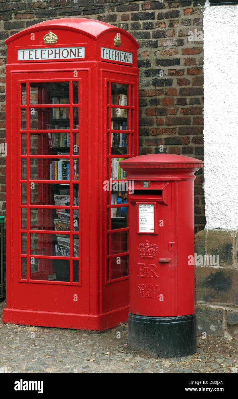 Classic,An,old,red,British,Telephone,box,turned,into,a,village,open,inside,being,made,into,lend,borrow,friendly,small,town,rural,demise,of,well,looked,after,gt,great,Budworth,Cheshire,east,west,new,mini,libraries,minilibrary,minilibraries,mini-libraries,kiosk,stocked,up,exchange,scheme,new,door,gotonysmith,We,are,hoping,people,will,use,them,on,a,regular,basis,and,every,time,they,take,a,book,they,will,leave,one,behind,book-exchange,read,reading,literature,literary,GPO,BT,BritishTelecom,British,Telecom,eccentric,eccentrics,English,England,beautiful,Englishness,redtelephone,redtelephonebox,with,pillar,pillarbox,old,types,of,communication,Buy Pictures of,Buy Images Of