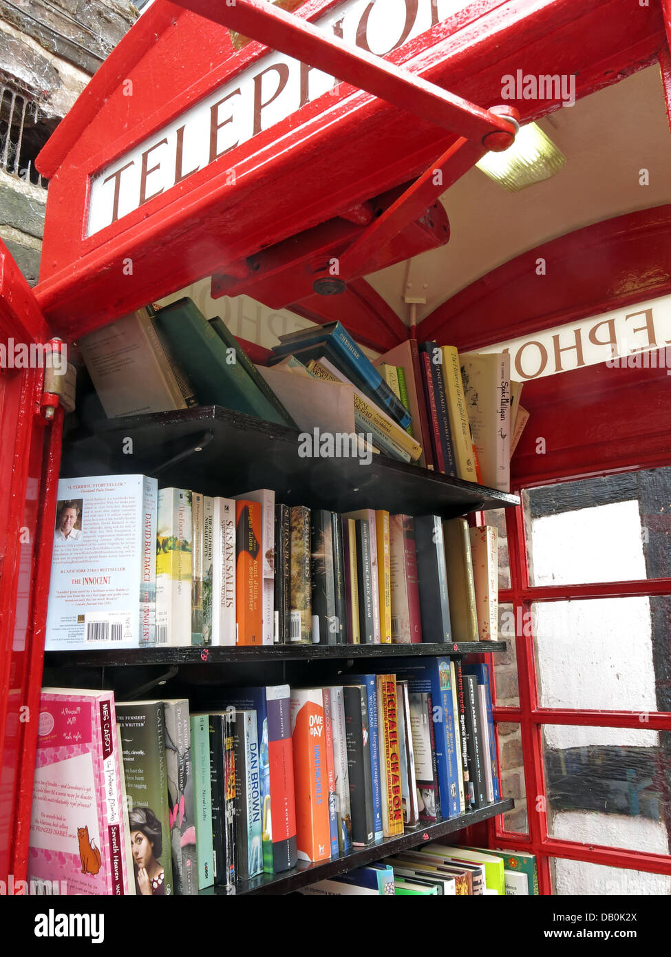 Classic,An,old,red,British,Telephone,box,turned,into,a,village,open,inside,being,made,into,lend,borrow,friendly,small,town,rural,demise,of,well,looked,after,gt,great,Budworth,Cheshire,east,west,new,mini,libraries,minilibrary,minilibraries,mini-libraries,kiosk,stocked,up,exchange,scheme,new,door,gotonysmith,We,are,hoping,people,will,use,them,on,a,regular,basis,and,every,time,they,take,a,book,they,will,leave,one,behind,book-exchange,read,reading,literature,literary,GPO,BT,BritishTelecom,British,Telecom,eccentric,eccentrics,English,England,beautiful,Englishness,redtelephone,redtelephonebox,Buy Pictures of,Buy Images Of