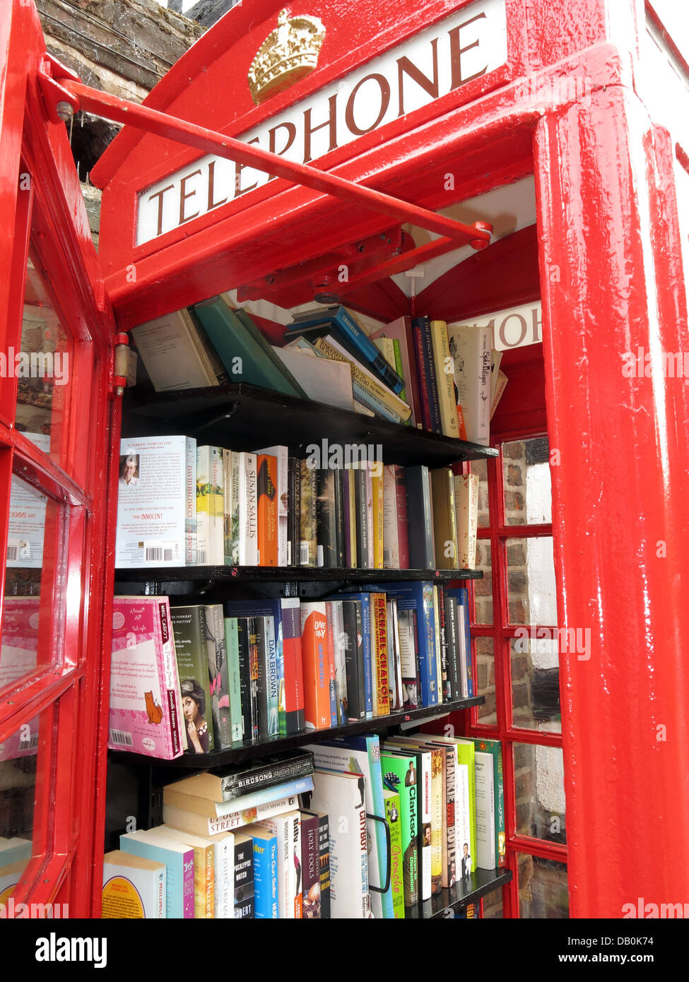 Classic,An,old,red,British,Telephone,box,turned,into,a,village,open,inside,being,made,into,lend,borrow,friendly,small,town,rural,demise,of,well,looked,after,gt,great,Budworth,Cheshire,east,west,new,mini,libraries,minilibrary,minilibraries,mini-libraries,kiosk,stocked,up,exchange,scheme,new,door,gotonysmith,We,are,hoping,people,will,use,them,on,a,regular,basis,and,every,time,they,take,a,book,they,will,leave,one,behind,book-exchange,read,reading,literature,literary,GPO,BT,BritishTelecom,British,Telecom,eccentric,eccentrics,English,England,beautiful,Buy Pictures of,Buy Images Of