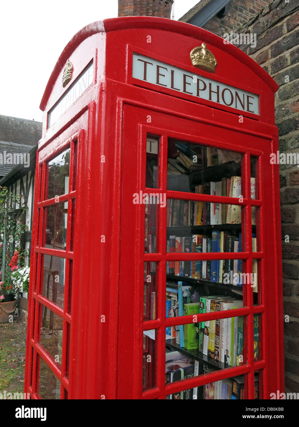 Classic,An,old,red,British,Telephone,box,turned,into,a,village,lending,library,being,made,into,lend,borrow,friendly,small,town,rural,demise,of,well,looked,after,gt,great,Budworth,Cheshire,east,west,new,mini,libraries,minilibrary,minilibraries,mini-libraries,kiosk,stocked,up,exchange,scheme,new,gotonysmith,We,are,hoping,people,will,use,them,on,a,regular,basis,and,every,time,they,take,a,book,they,will,leave,one,behind,book-exchange,read,reading,literature,literary,GPO,BT,BritishTelecom,British,Telecom,eccentric,eccentrics,English,England,beautiful,Buy Pictures of,Buy Images Of