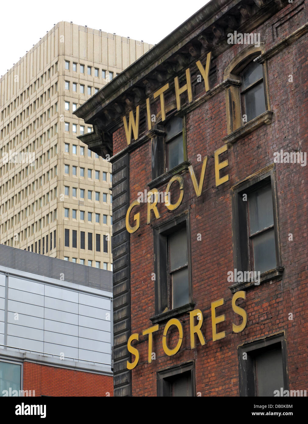 The,old,withy,Grove,Stores,victorian,building,in,Shudehill,Manchester,City,Centre,with,the,1970s,Arndale,shopping,precinct,classic,mancunian,industrial,warehouse,cotton,Withy,Grove,Stores,Ltd,Withy,Grove,Stores,Ltd,is,situated,on,Withy,Grove,in,Manchester,city,centre,and,supplies,commercial,safes,gotonysmith,WithyGrove,fire,protection,Established,in,1850,old,firm,firms,family,housed,in,a,fantastic,old,building,business,classic,King,Mancester,Buy Pictures of,Buy Images Of