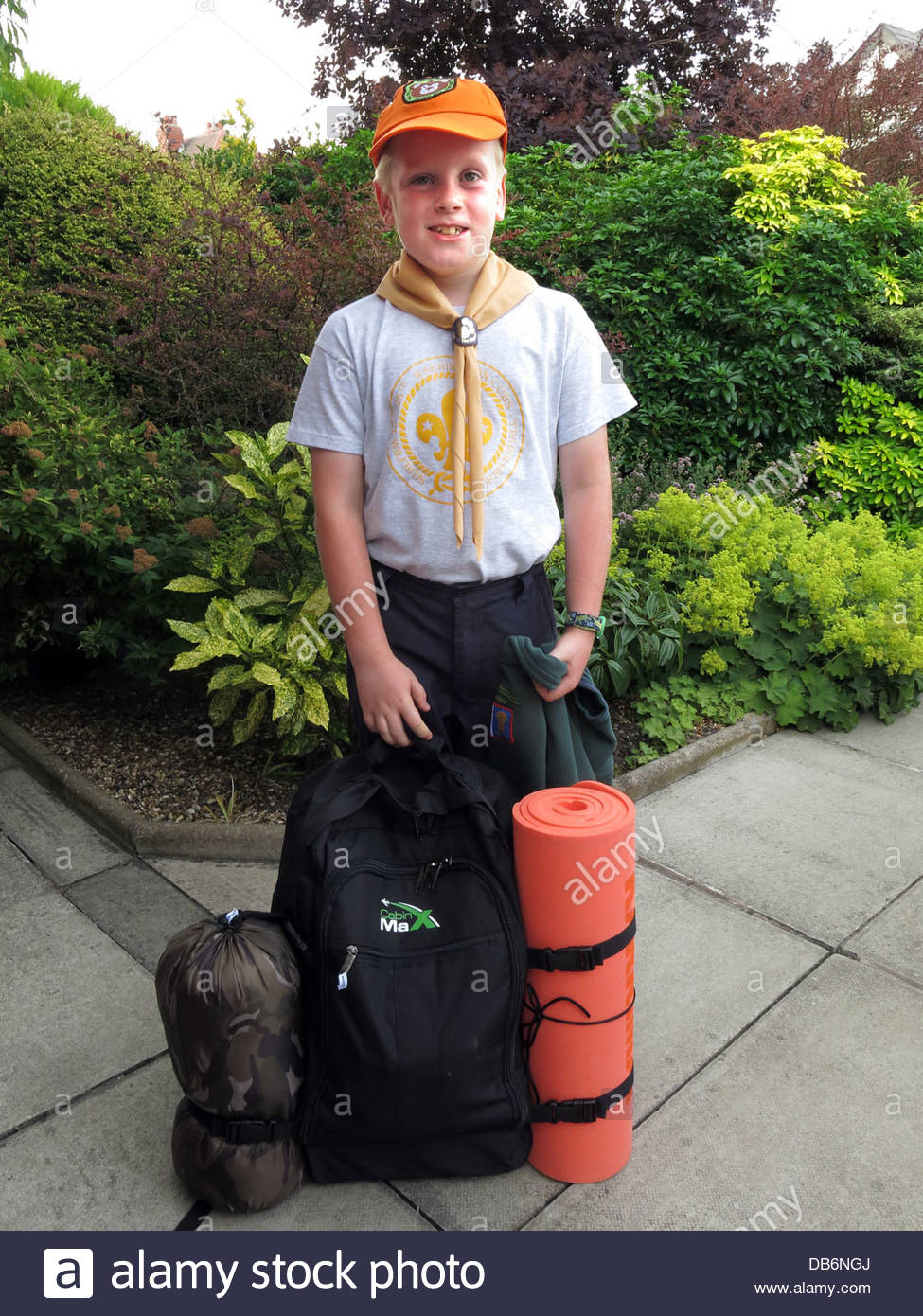 boy,lad,in,uniform,cubs,smiling,happy,summer,rucksack,bag,litbag,kit,woggle,camping,outdoors,badge,standing,proud,to,be,a,outside,cubcamp,9,nine,years,old,year,child,children,Warrington,east,Grappenhall,NW,north,west,northwest,England,Cheshire,UK,United,Kingdom,UK,GB,Great,Britain,british,full,gotonysmith,orange,cap,hat,Buy Pictures of,Buy Images Of