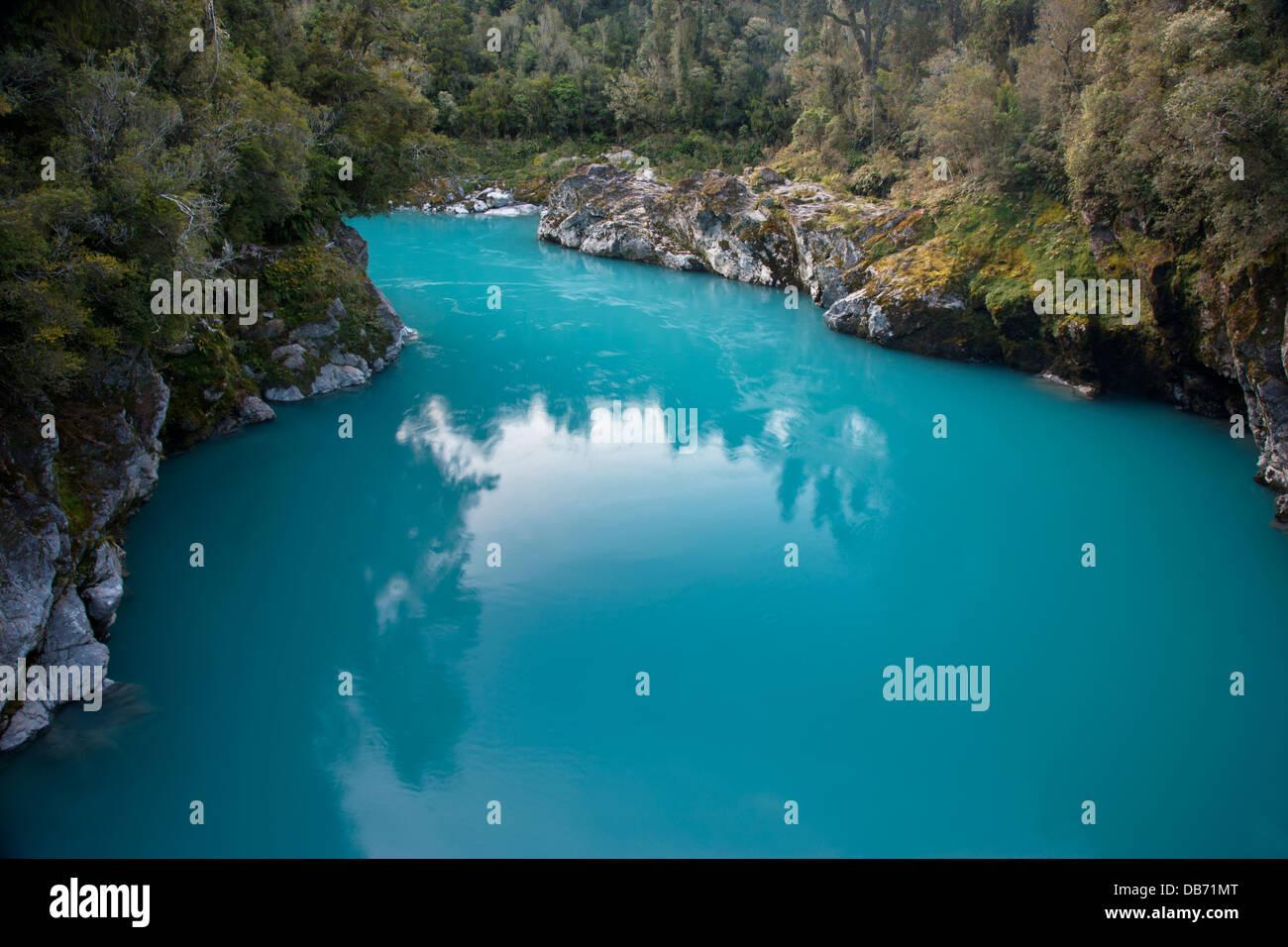 South Pacific, New Zealand, South Island. The glacial, flour-laden Hokitika River. - Stock Image