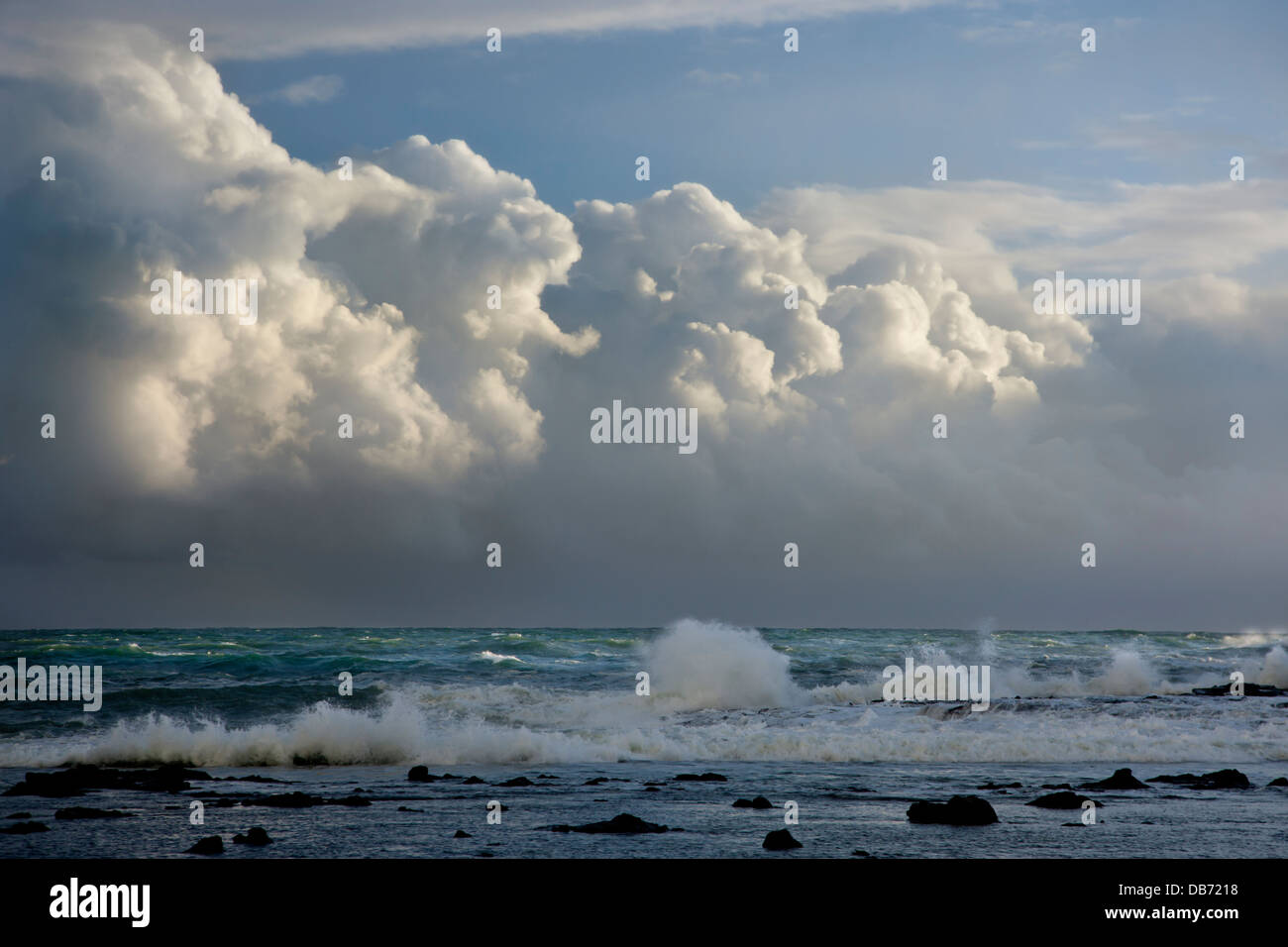 South Pacific, New Zealand, South Island. Storm clouds roll down the coastline at Curio Bay. - Stock Image