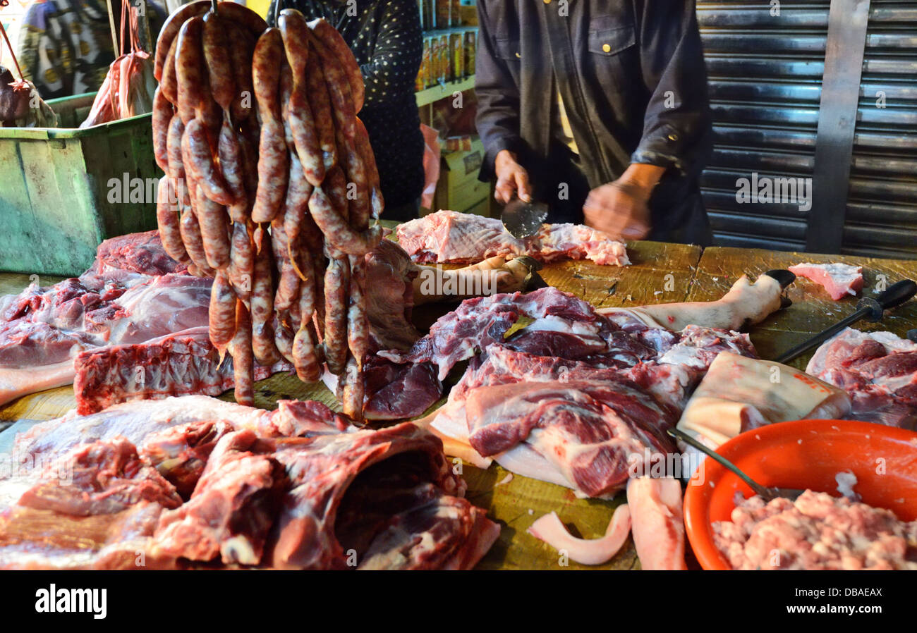 Meats being butchered at a Taiwanese food market. - Stock Image