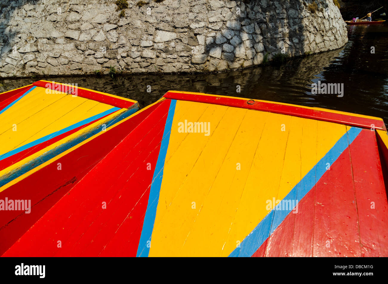 Bright colors of the boats in the Xochimilco Canal in Mexico City - Stock Image