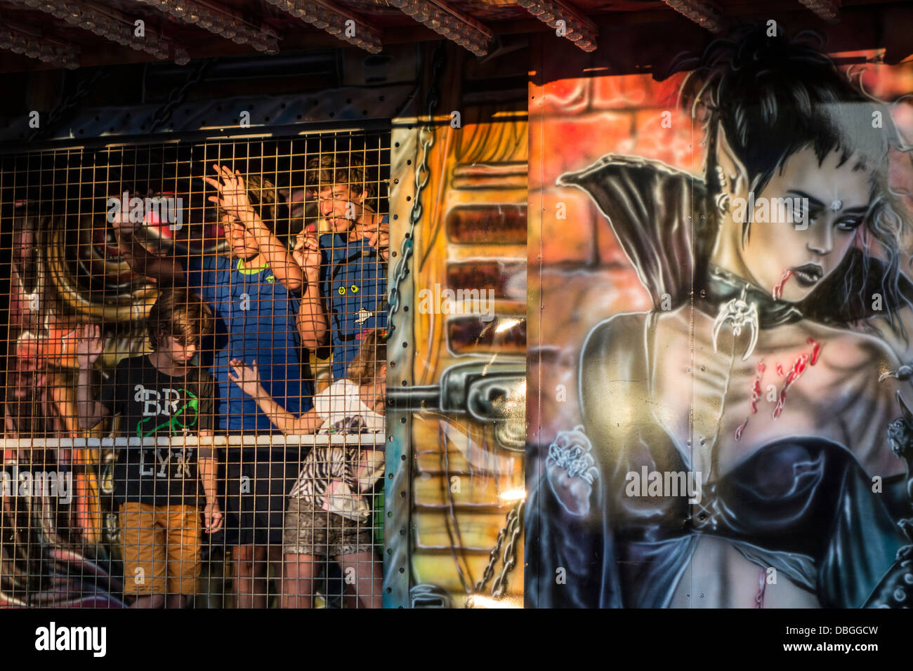 Children in fairground attraction haunted house at travelling funfair / traveling fun fair - Stock Image