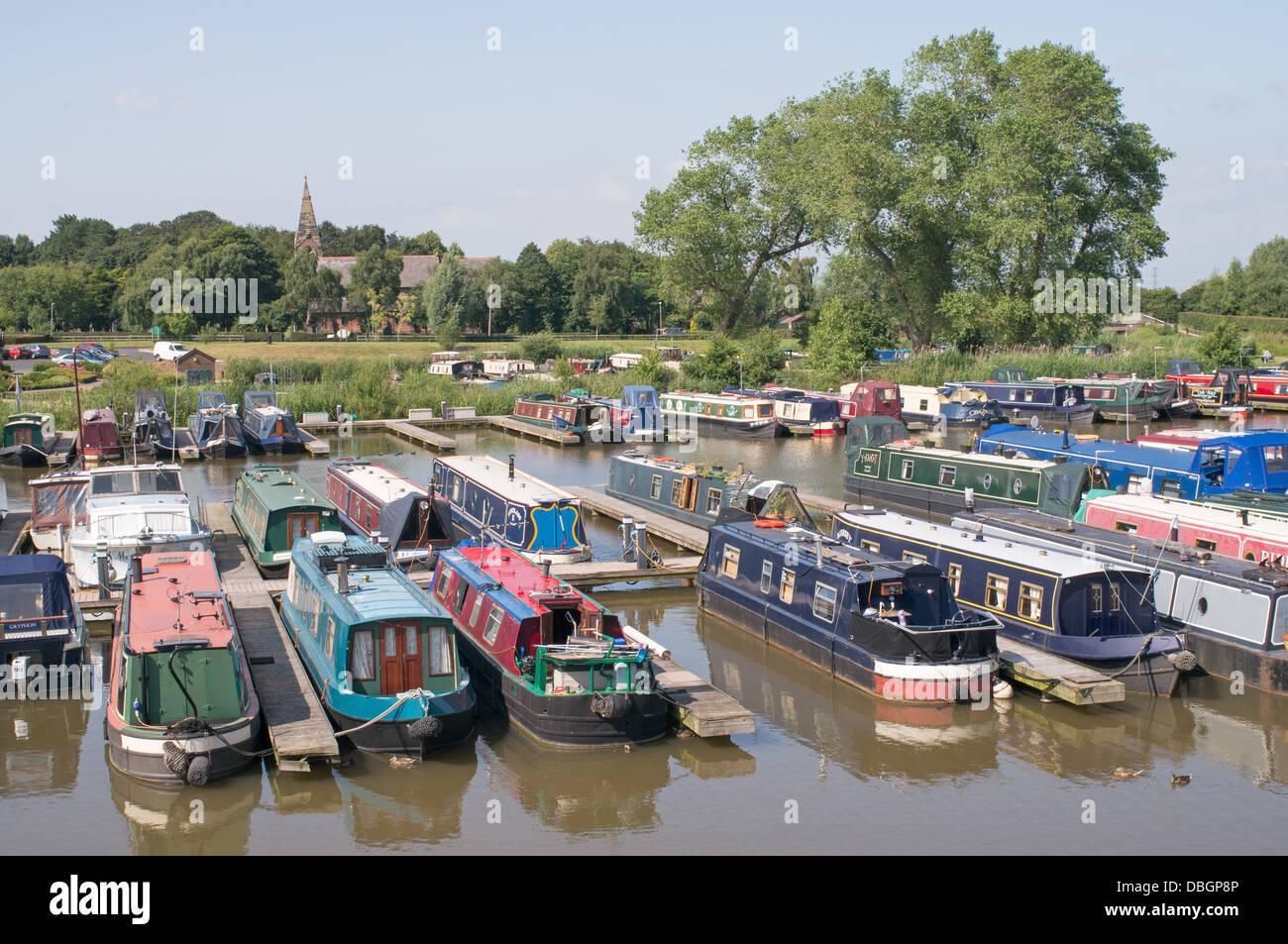 Canal narrow boats moored at St Mary's Marina, Rufford, north west England, UK - Stock Image