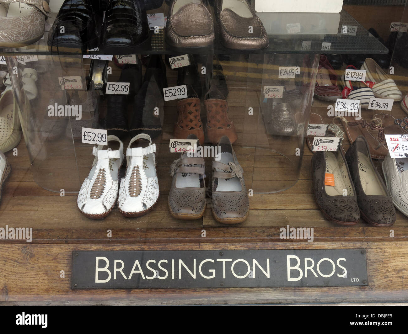 Bros,traditional,footwear,shop,disappearing,from,our,every,day,high,streets,ST3,1BS,ST31BS,Great,Britain,Longton,Stoke-on-trent,Staffordshire,England,UK,in,a,window,old,fashioned,sign,and,products,goods,service,Gotonysmith,Buy Pictures of,Buy Images Of