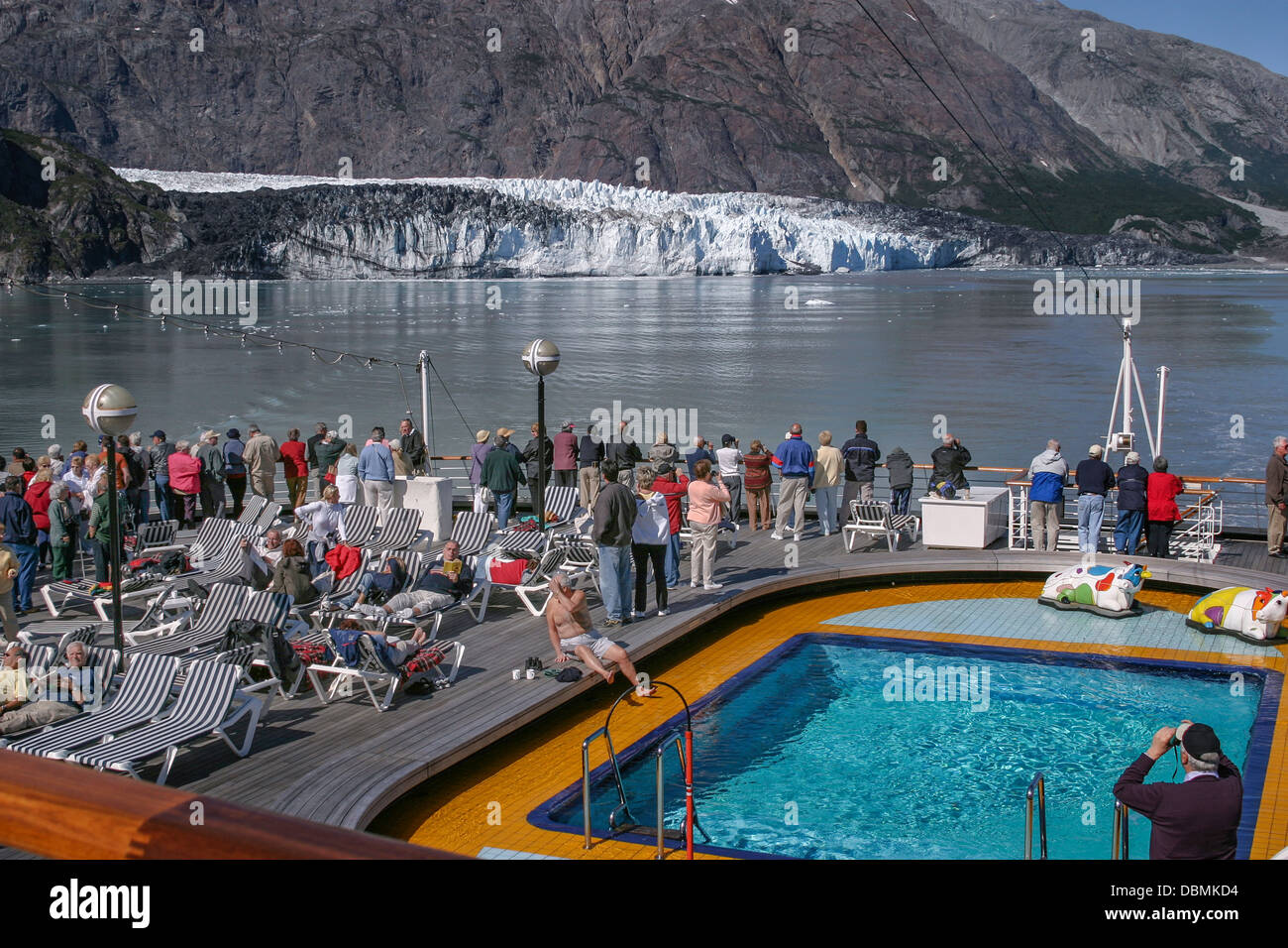 Passengers on cruise ship looking at glaciers on Alaskan coast, USA Stock Photo