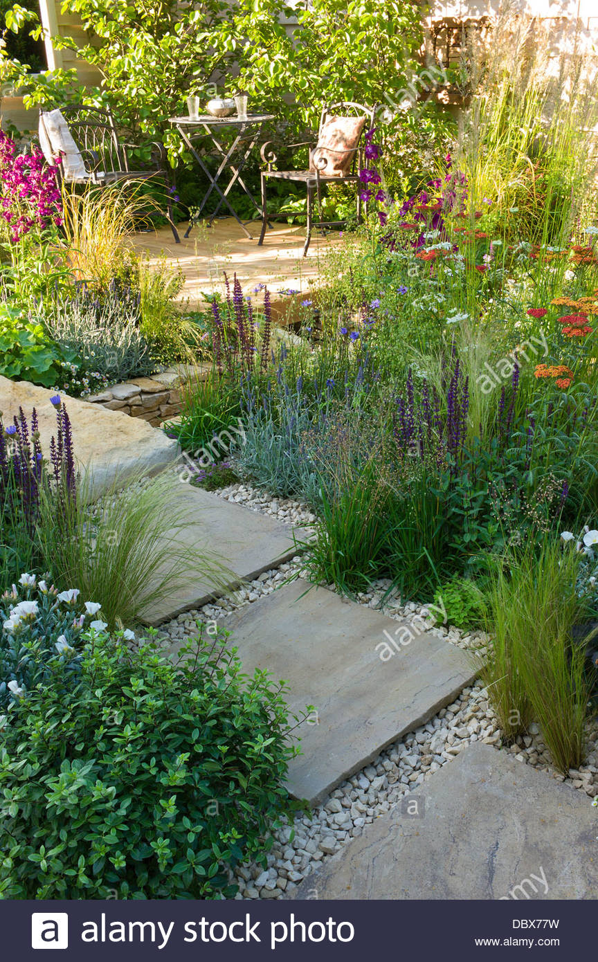 Small Garden With Winding Stone Paving, Gravel Path And
