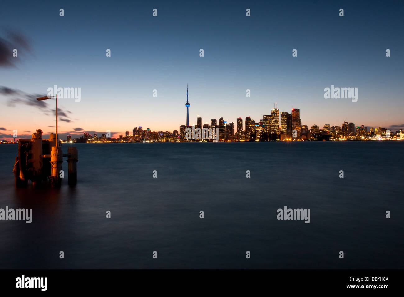 Toronto Skyline at night as viewed from Ward Island Ferry Dock. - Stock Image