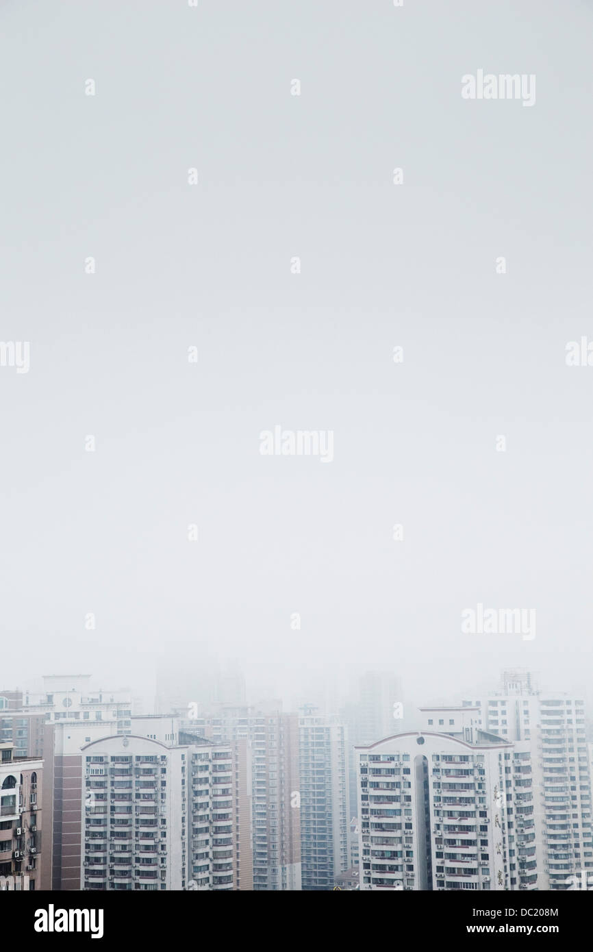 High angle view of mist over skyscrapers, Shanghai, China - Stock Image