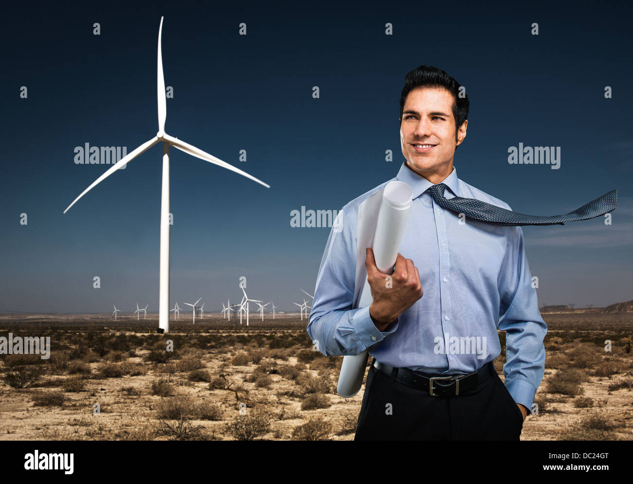 Man standing in front of wind farm - Stock Image