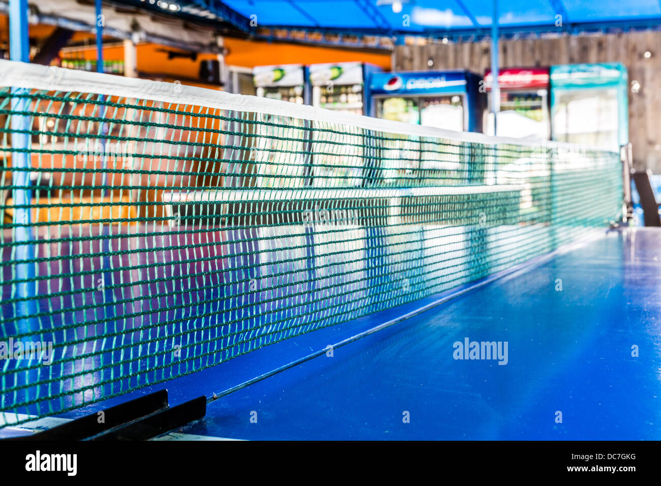 Closeup of a table tennis net in a bar - Stock Image