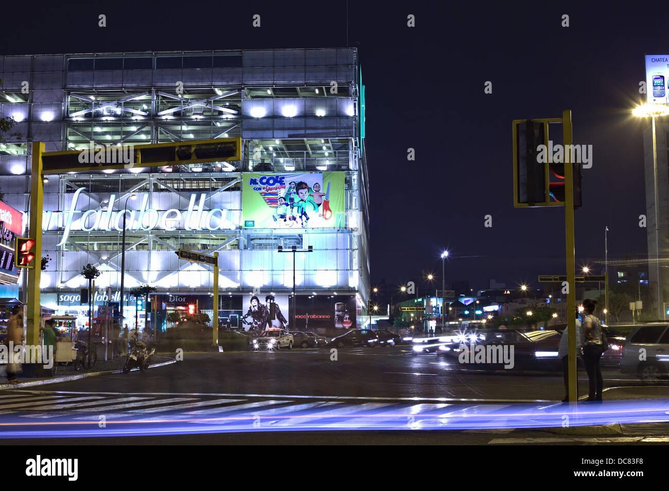 Saga Falabella department store at Ovalo Miraflores in the district of Miraflores, Lima, Peru at Night - Stock Image