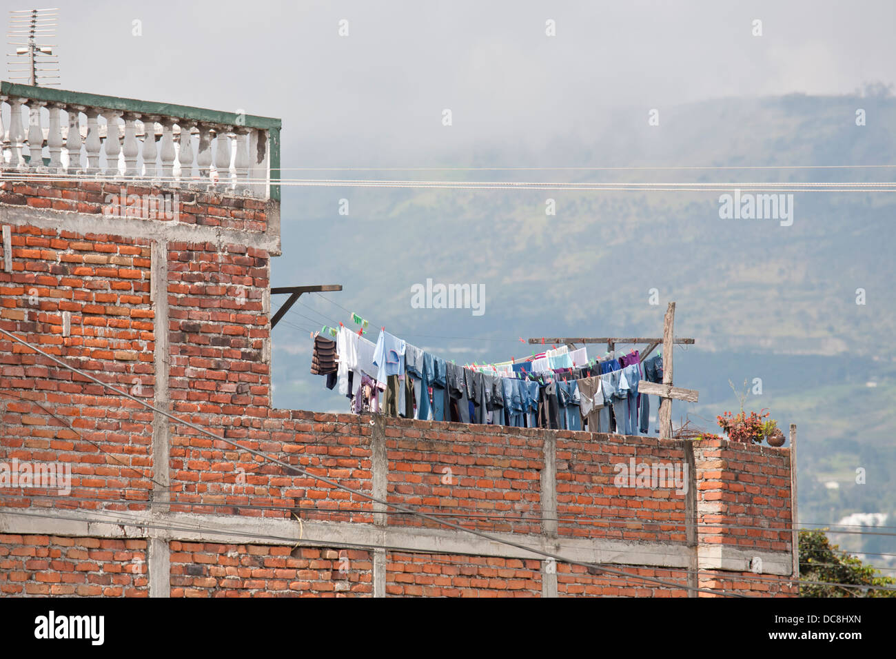 South America, Ecuador, Quito. Laundry hanging on a line to dry. - Stock Image