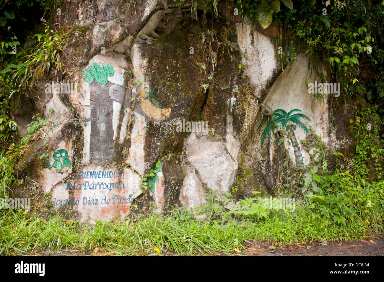 South America, Ecuador, El Chaco. An old sign painted on a rock wall. - Stock Image
