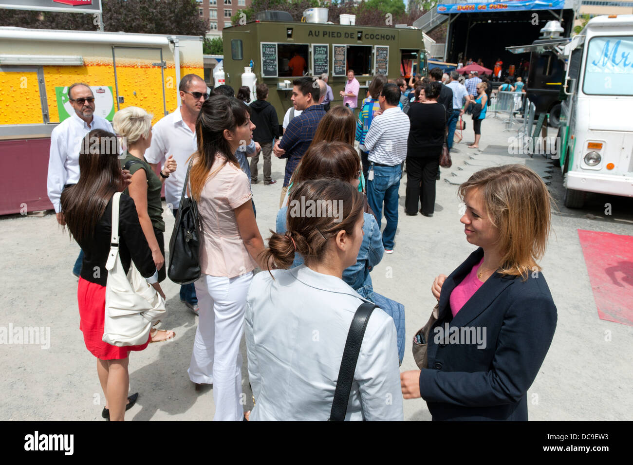 People line up at a mobile food vendor, Montreal. - Stock Image
