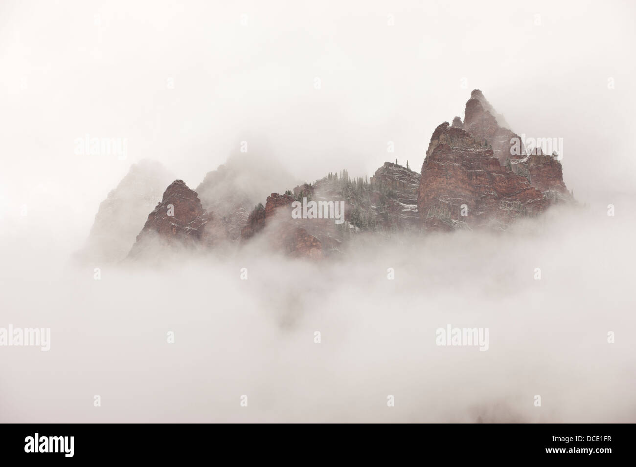 USA, Colorado, Aspen. Sievers Mountain with clouds swirling among its spires. - Stock Image