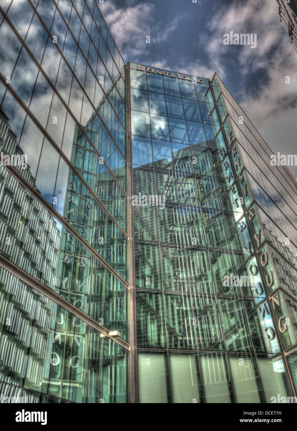 South,bank,southwark,glass,building,tower,towering,architecture,finance,financial,accountancy,services,accountant,EY,HQ,headquarters,headquarter,firm,firms,crash,city,of,assurance,tax,advice,advisory,big,business,Arthur,Whinney,reflection,reflections,cloud,clouds,more,place,ten,story,foster,gotonysmith,practice,office,practices,fingers,glass,balustrades,partners,Designed,as,a,new,headquarters,for,Ernst,&,Young,the,ten-storey,1,More,London,Place,provides,the,company,with,35,000 square metres of high-quality,flexible,office,space,on,the,south,bank,of,the,River,Thames,between,London,and,Tower,Bridges.,A,full-height,atrium,links,the,building's,two,'fingers',of,office,space,creating,a,dramatic,entrance,space,which,is,crisscrossed,with,three,bridges,per,floor,with,glass,balustrades.,The,central,concrete,core,and,four,peripheral,steel,cores,are,clad,with,extruded,aluminium,panels.,The,24m-wide,column-free,floor,plates,benefit,from,generous,amounts,of,daylight,through,the,atrium,glazed,facades,energy,usage,Bermondsey,LDSA,Built,in,Quality,Awards,Winner,Large,Commercial,category,Buy Pictures of,Buy Images Of
