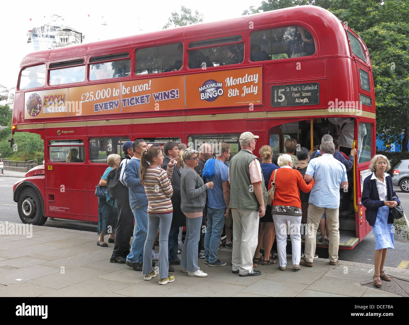 boarding,getting,on,classic,city,transports,15,number,no15,traditional,old,fashioned,ourist,travel,travellers,sightsee,sightseeing,sightseers,tower,hill,of,England,UK,united,kingdom,europe,route,st,pauls,cathedral,route15,TFL,for,double,decker,double-decker,heritage,route,vehicle,Transport,AEC,LT,RM,gotonysmith,Pauls,doubledecker,deck,upstairs,top,vehicles,routes,omnibus,heritageroutes,Stagecoach,company,services,between,Trafalgar,Square,and,Tower,Hill,ALM71B,ALM,71B,crowd,line,queue,wait,waiting,patiently,Buy Pictures of,Buy Images Of,English queue,British queue