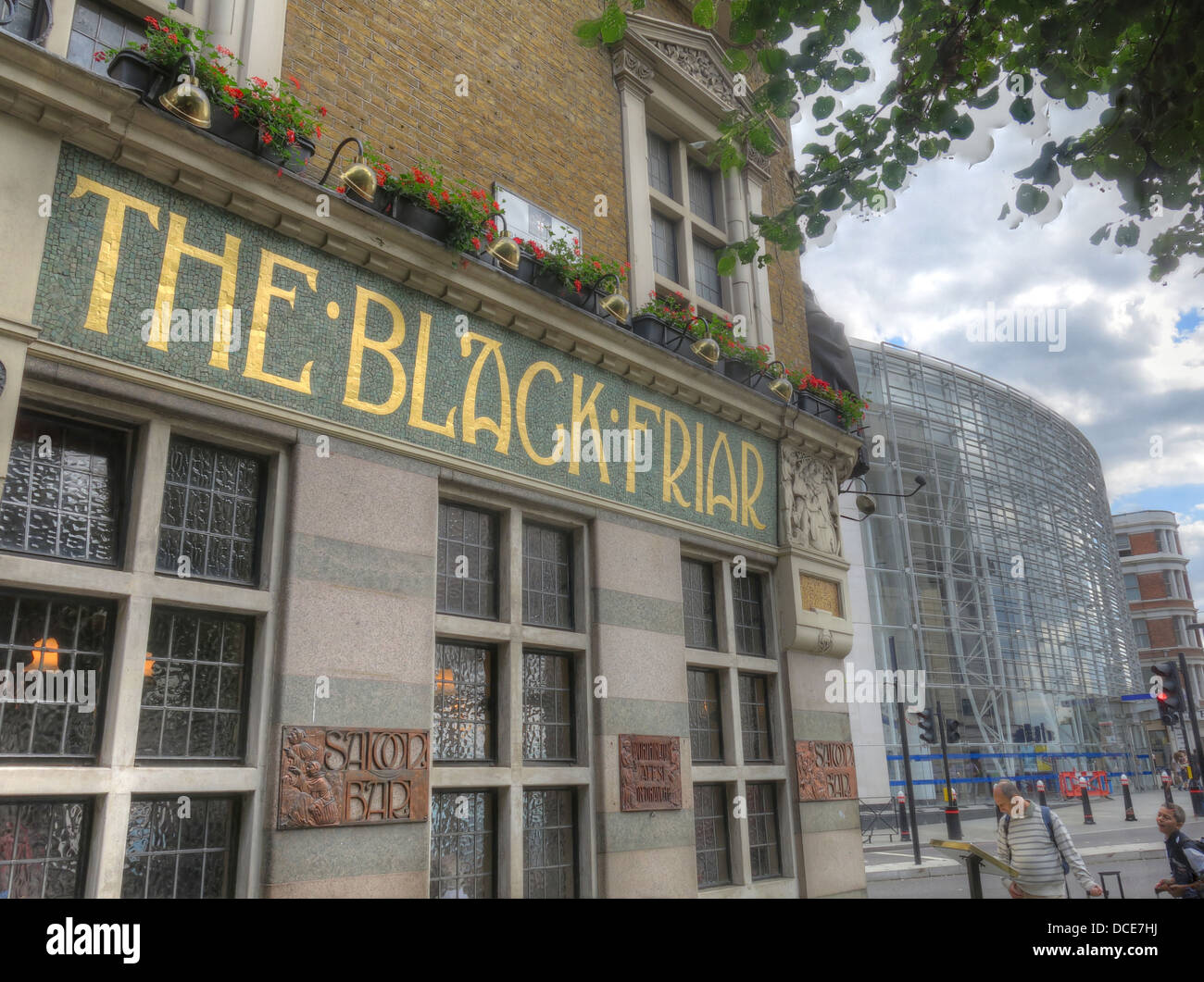 Classic,bar,public,house,mosaic,station,tube,underground,CAMRA,pubs,GB,Great,British,Britain,English,England,174,Queen,Victoria,Street,EC4V,4EG,EC4V4EG,belonging,to,Nicholsons,a,chain,founded,in,1905,in,the,Arts,and,Crafts,Nicholsons,Nicholson,real,ale,beers,beer,cider,art,arty,drink,pint,a,at,gotonysmith north of the Thames traditional unique pubs Bridge,Upper,Thames,Street,and,Fleet,Street,history,historic,Art,Nouveau,Grade,II,masterpiece,of,a,pub,was,built,in,1905,on,the,site,of,a,Dominican,friary,The,building,was,designed,by,architect,H.,Fuller-Clark,and,artist,Henry,Poole,both,committed,to,the,free-thinking,of,the,Arts,and,Crafts,Movement,Jolly,friars,appear,everywhere,in,the,pub,in,sculptures,mosaics,and,reliefs,wonderful,pub,was,saved,from,demolition,by,a,campaign,led,by,Sir,John,Betjeman,pubs,bars,of,London,classic,tourist,attraction,travel,vacation,Buy Pictures of,Buy Images Of,Pubs Of London,must see