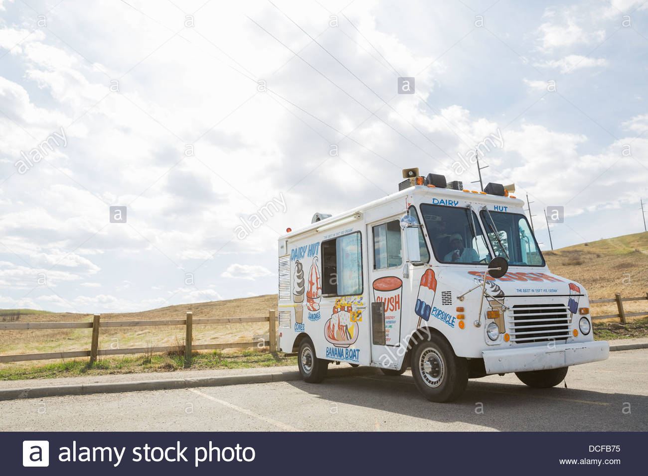 Ice cream truck parked in parking lot - Stock Image
