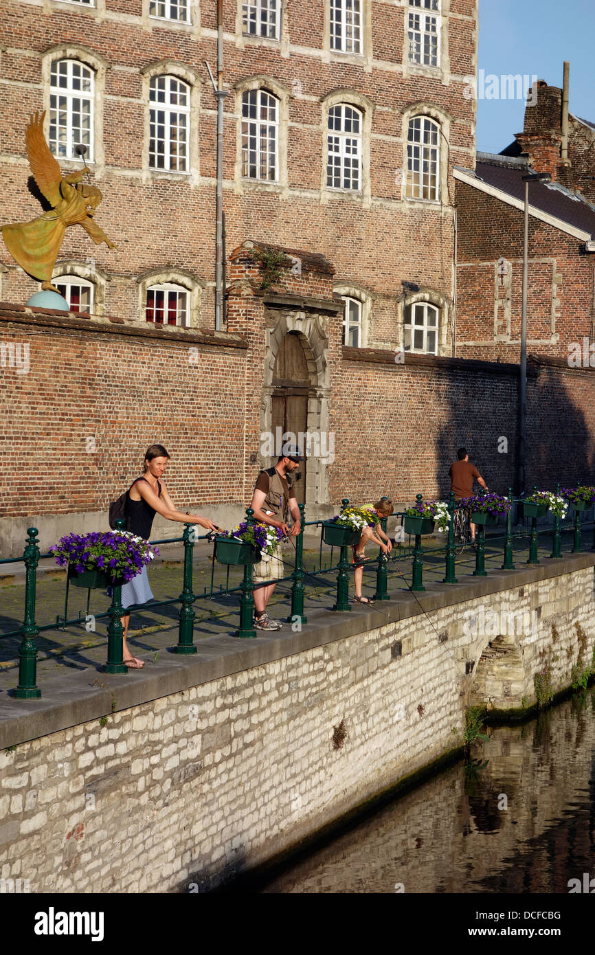 Family of anlers angling in water of the river Lieve along the Augustijnenkaai in Ghent, East Flanders, Belgium - Stock Image