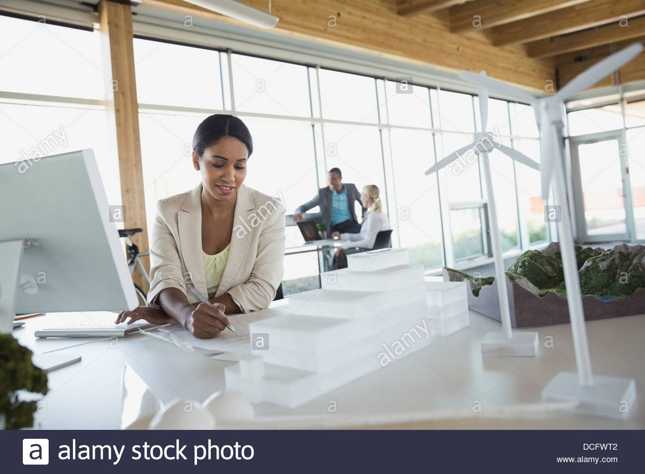 Sustainable energy engineer working on prototypes and blueprints - Stock Image