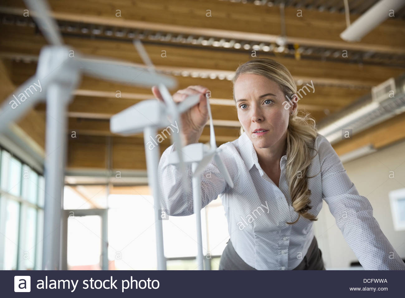 Sustainable energy engineer working with prototypes - Stock Image