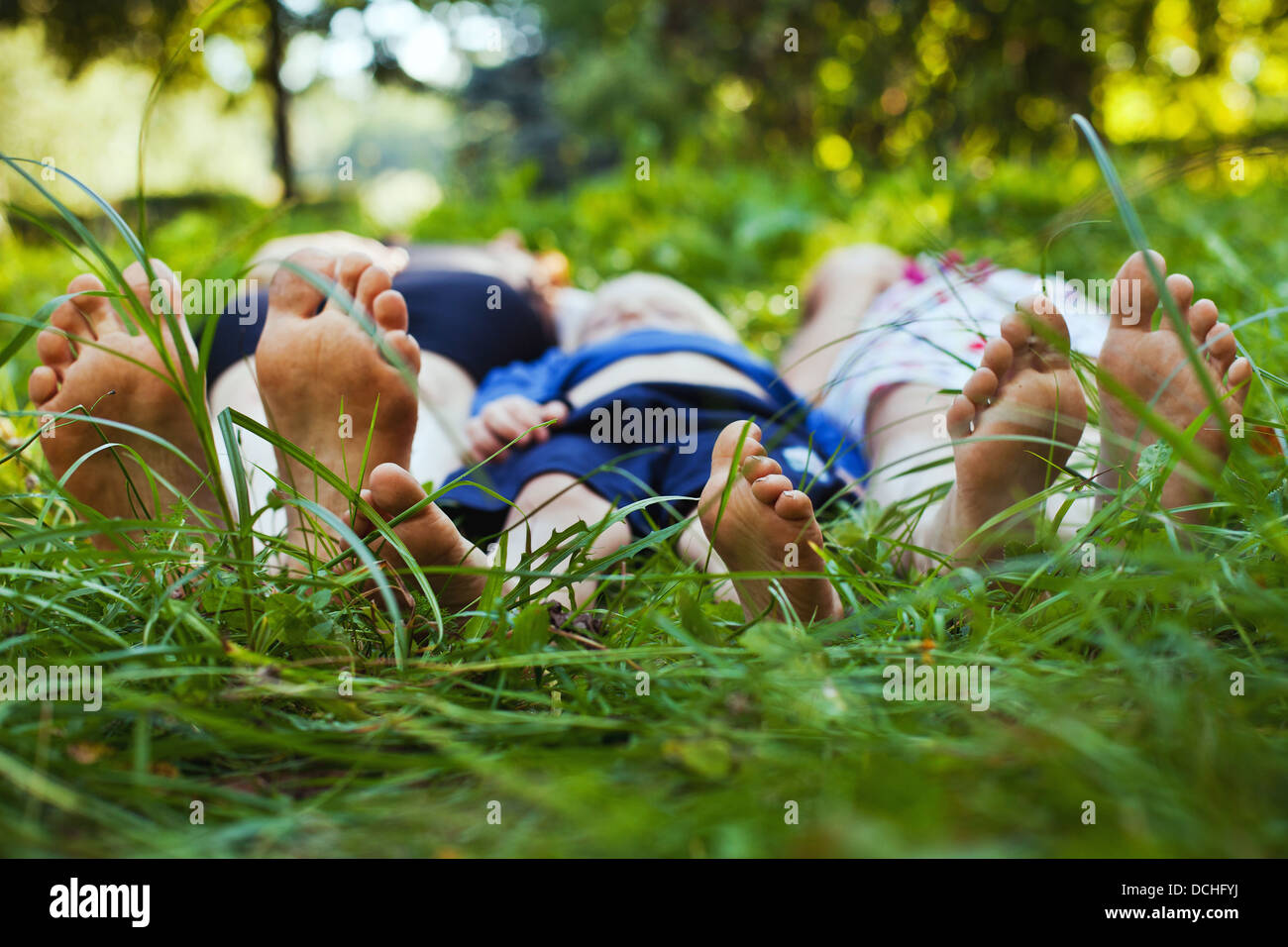 family relaxing on the grass - Stock Image