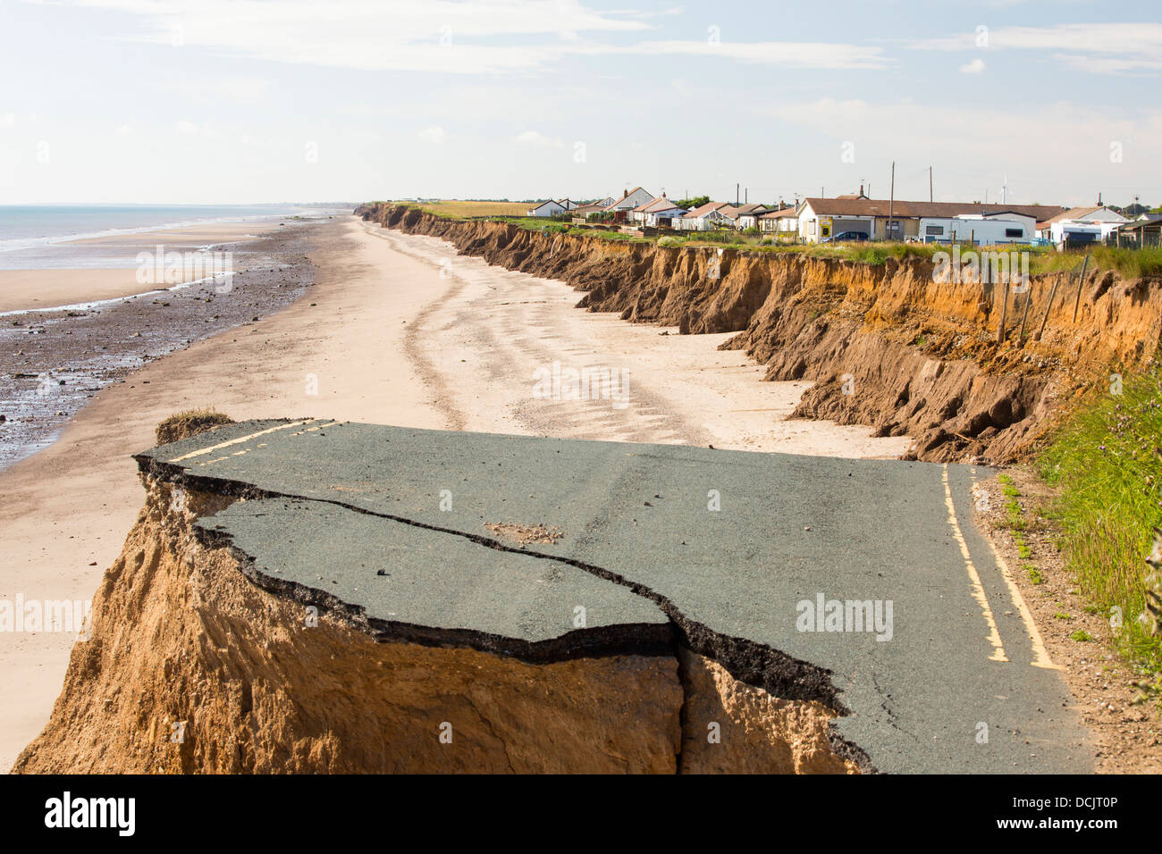 A collapsed coastal road at between Skipsea and Ulrome on Yorkshires East Coast, near Skipsea, UK. - Stock Image