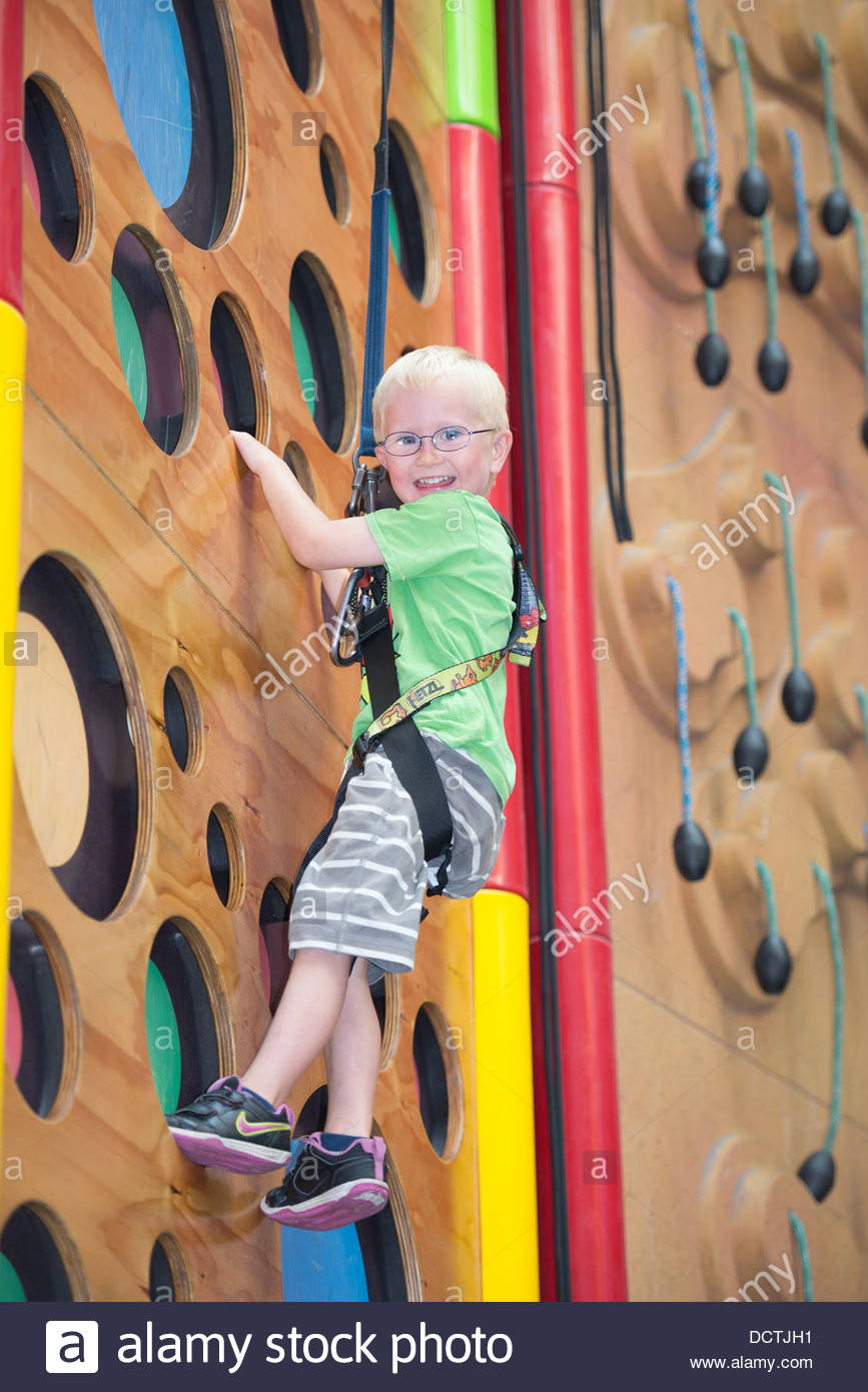 young person on a climbing wall - Stock Image