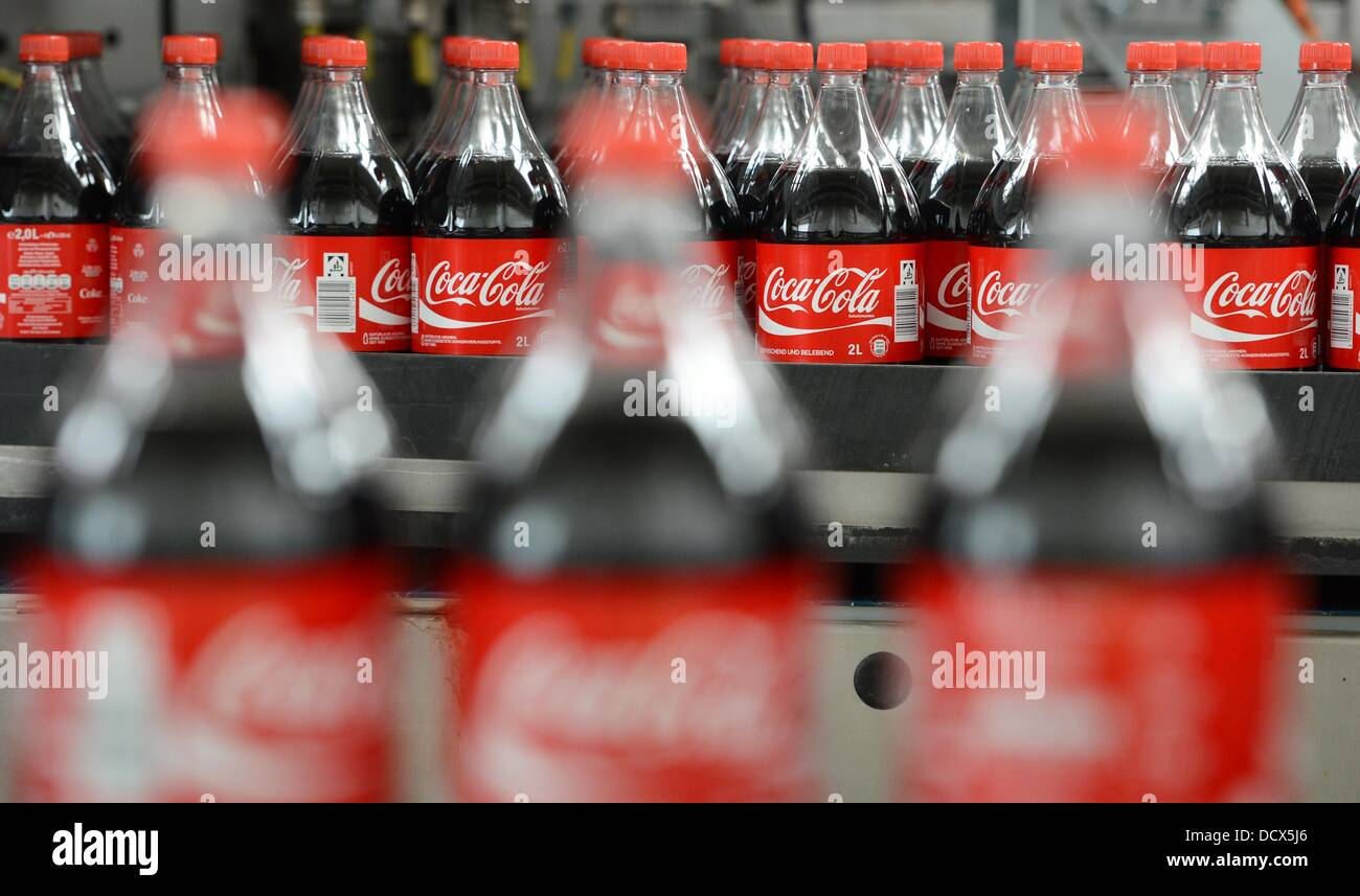 Two-liters Coca-Cola bottles are pictured on the production line in ...